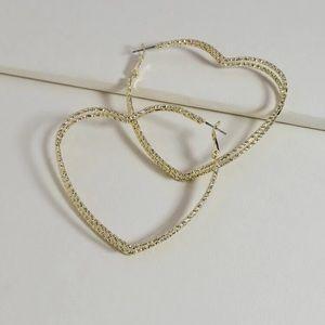 Gold heart shaped earrings.